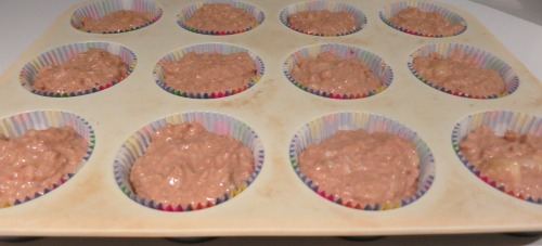Muffin Mixture into Lined Muffin Tray