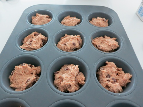 Muffin mixture in muffin pan